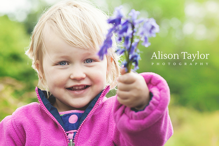 Photo of a girl holding flowers during family photo shoot in bristol