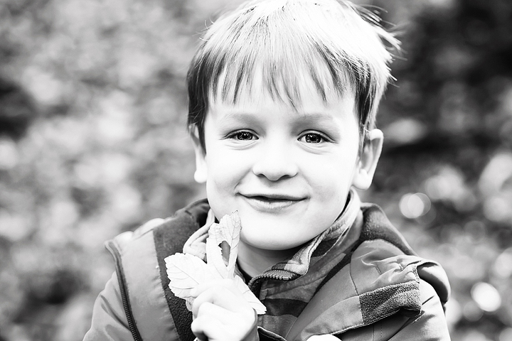 Photo of a boy holding a leaf during a photo shoot