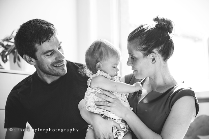 Photo of a family during a photo shoot for a six year old baby