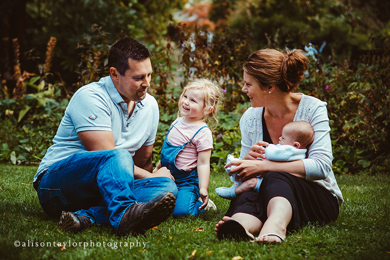 Photo of a family in a garden during a family photo shoot