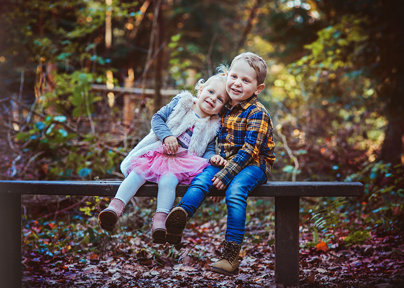 Photo of brother and sister in the woods during photo shoot in bristol