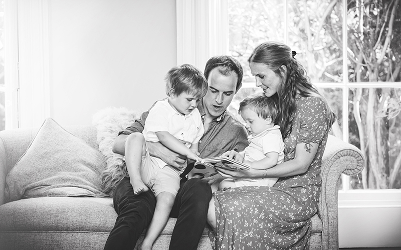 Photo of a family sitting together during a family photo shoot in cheltenham