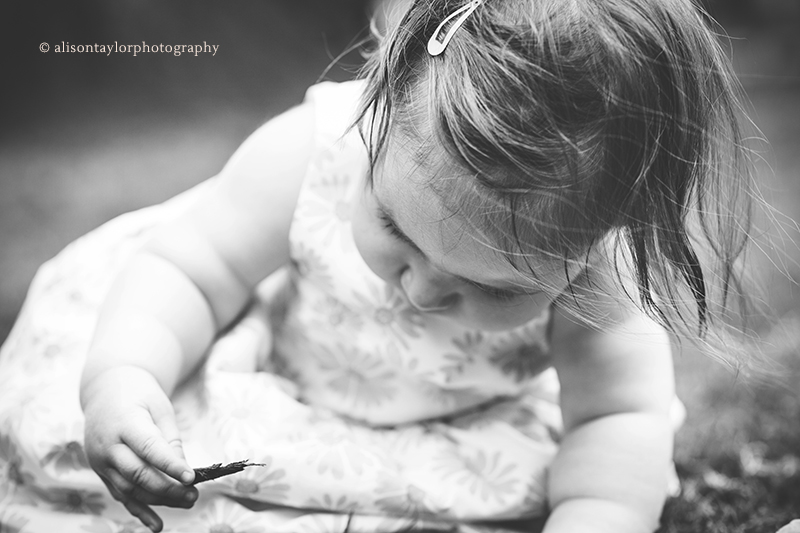 Photo of a one year old girl exploring during a photo shoot in Bristol