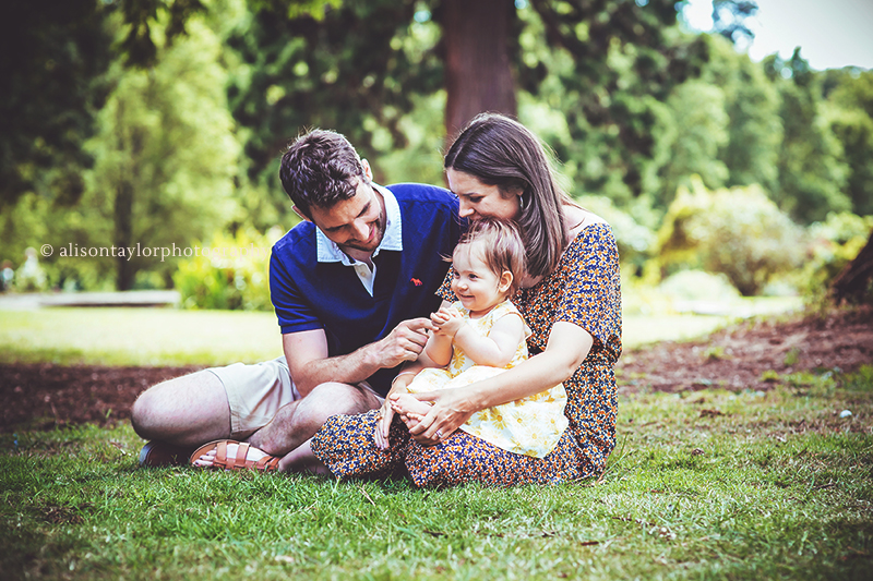 family sitting in a park - children photography bristol