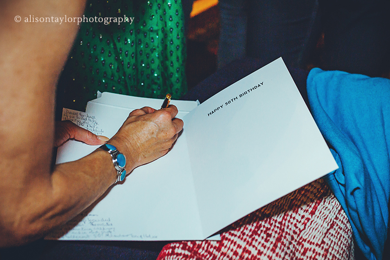 Birthday card being written at a party