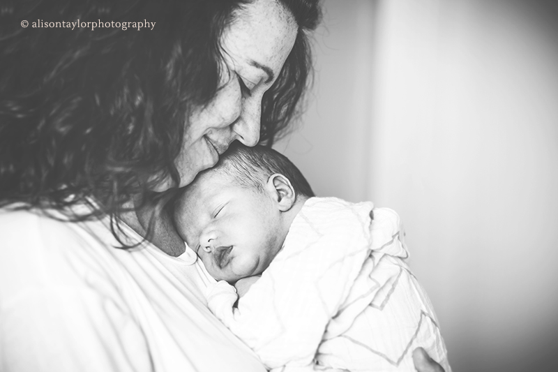 Photo of a mother and her newborn baby during a photo shoot in Bristol