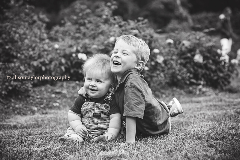young brothers laughing and sitting on the grass - family photos bristol