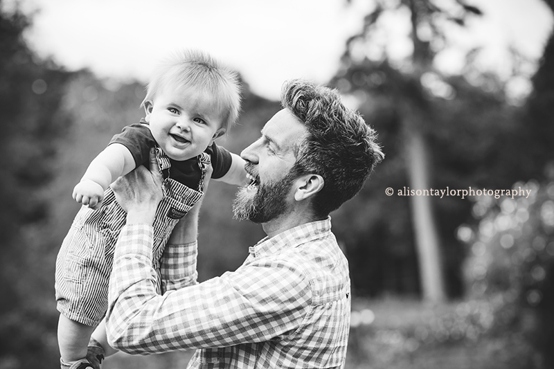 father holding little boy in the air - family photos bristol