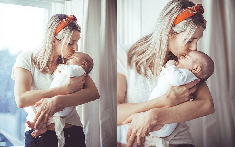 mother kissing newborn baby during a newborn baby photo shoot in Bath by Alison Taylor Photography