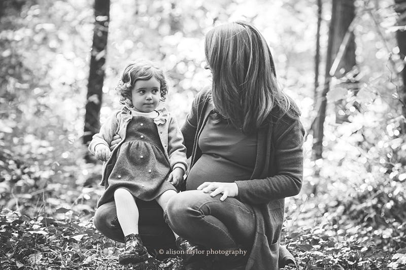 photo of a pregnant mother with daughter during a photo shoot at Leigh Woods in Bristol