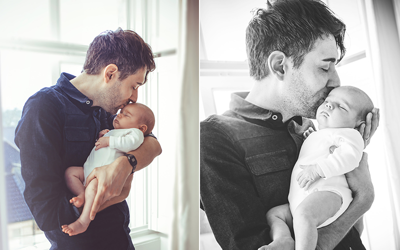 father  kissing newborn baby - newborn photographer bath