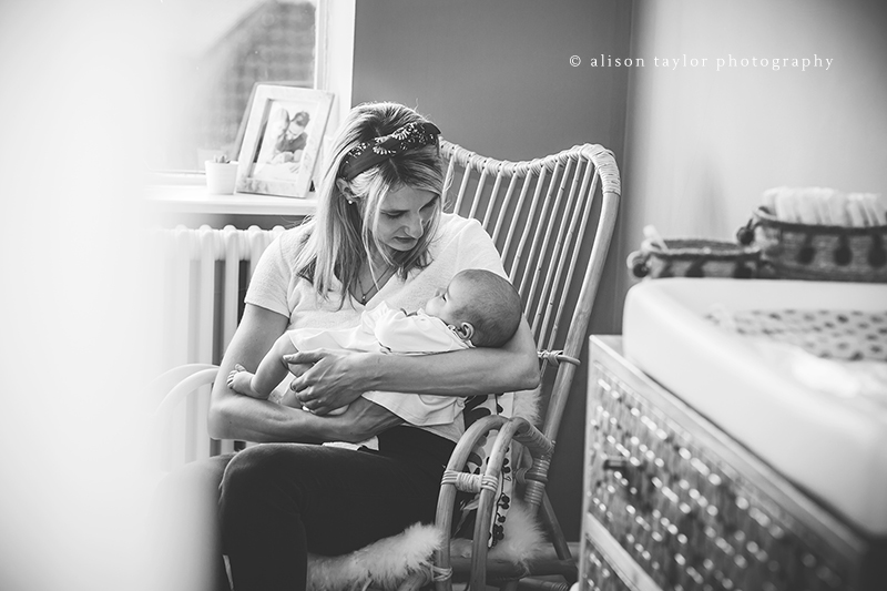 mother cradling newborn baby in a rocking chair - newborn photographer bath