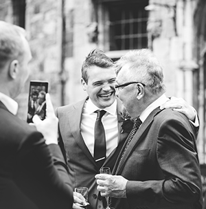 event and wedding photography - groom with friends