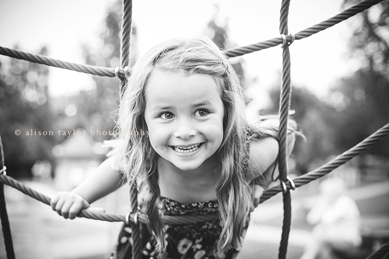 Portrait of a girl playing - family photographer cheltenham