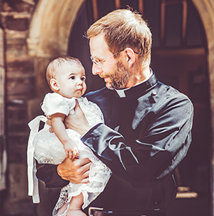 priest with baby