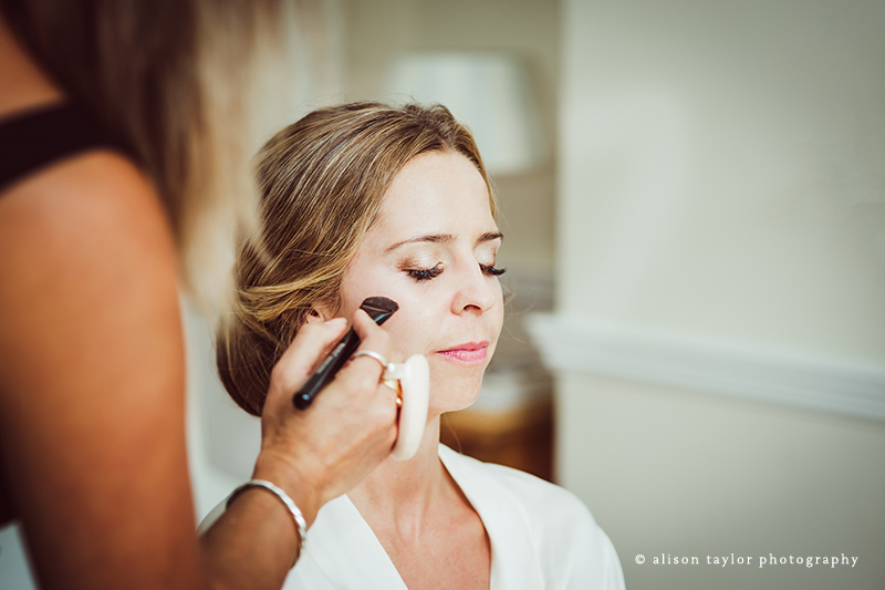 bride getting  make up done for wedding and christening in Bath