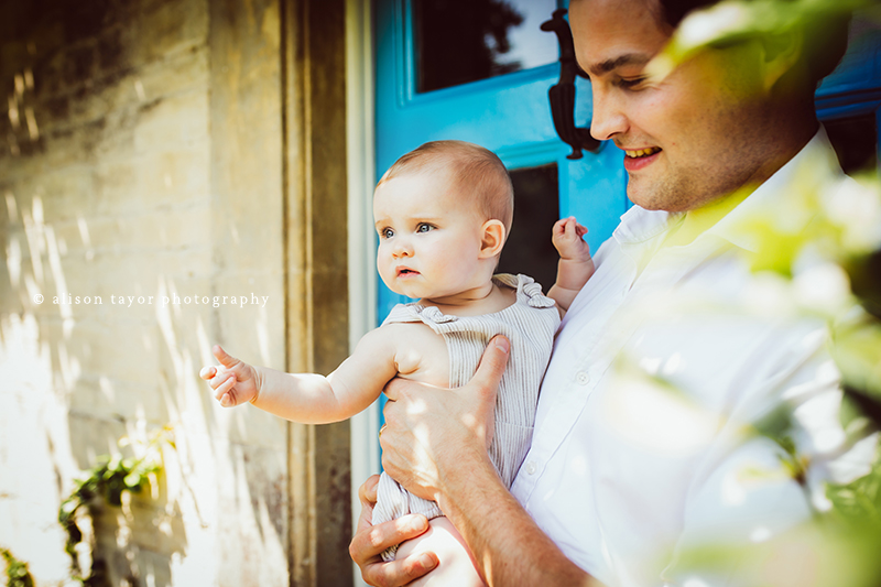 photo of a father holding his baby during a photo shoot