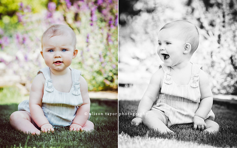 photo of a  baby sitting on the grass during a photo shoot