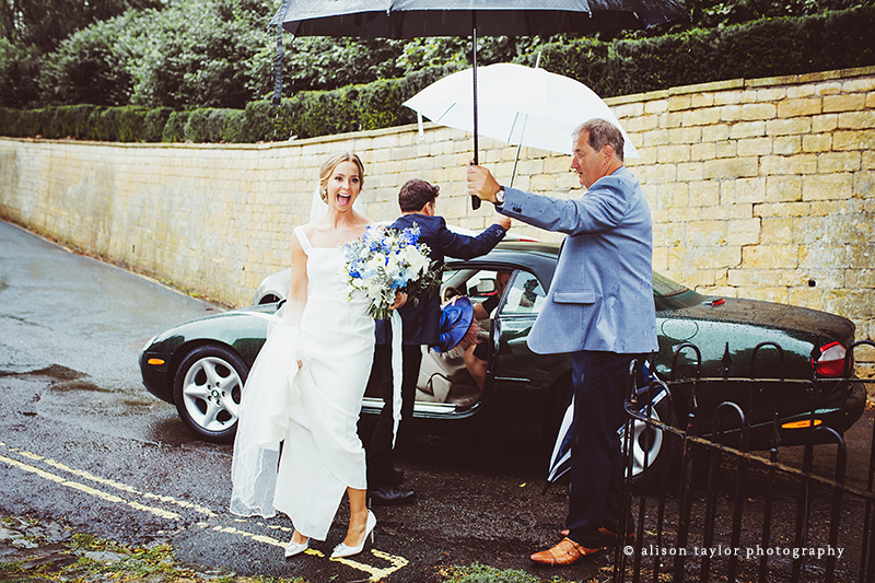 bride arriving at church for wedding and christening in Bath