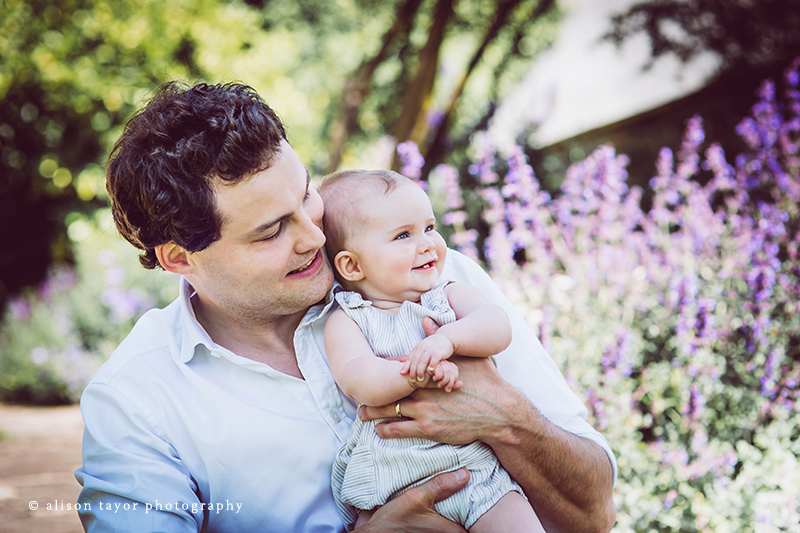 photo of father with baby during a photo shoot