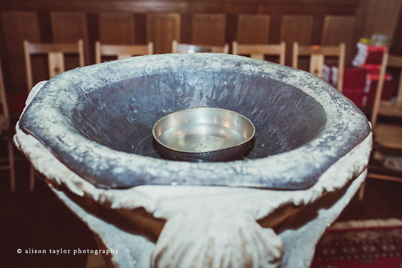 water in font for christening